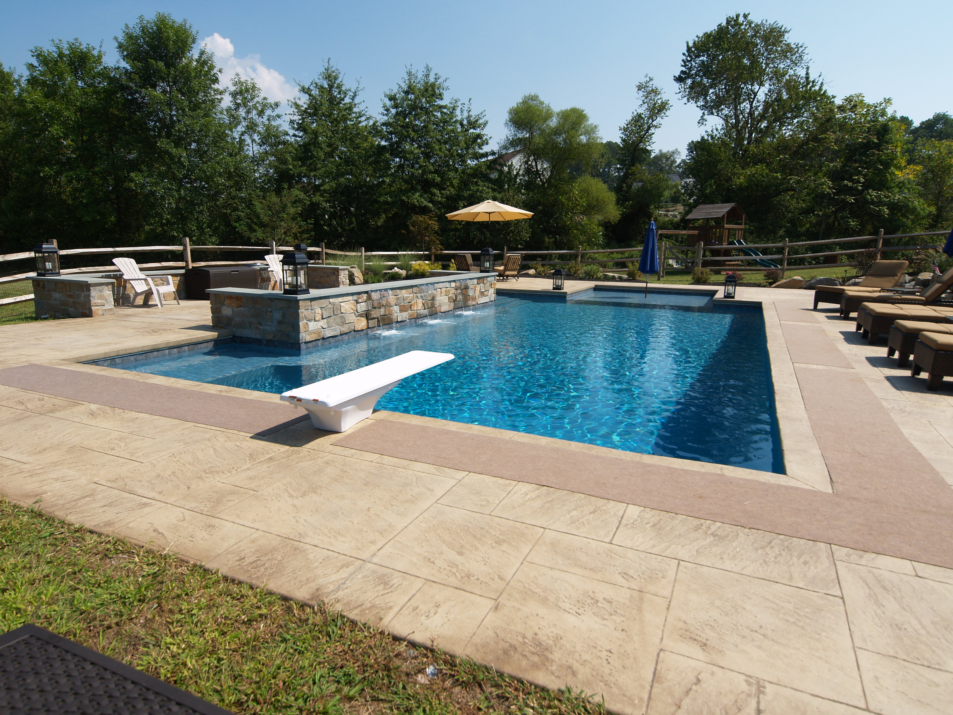 I like the bench around the water feature | Kozak Kastle - Pool ...