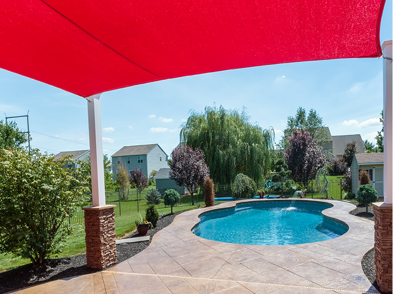 Freeform pool with red canopy