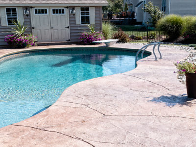 stamped-concrete-and-pool-house