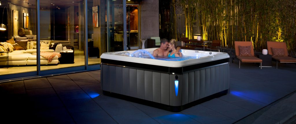 Couple enjoying romantic date in the hot tub